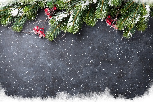 Christmas stone background with snow fir tree. Top view with copy space