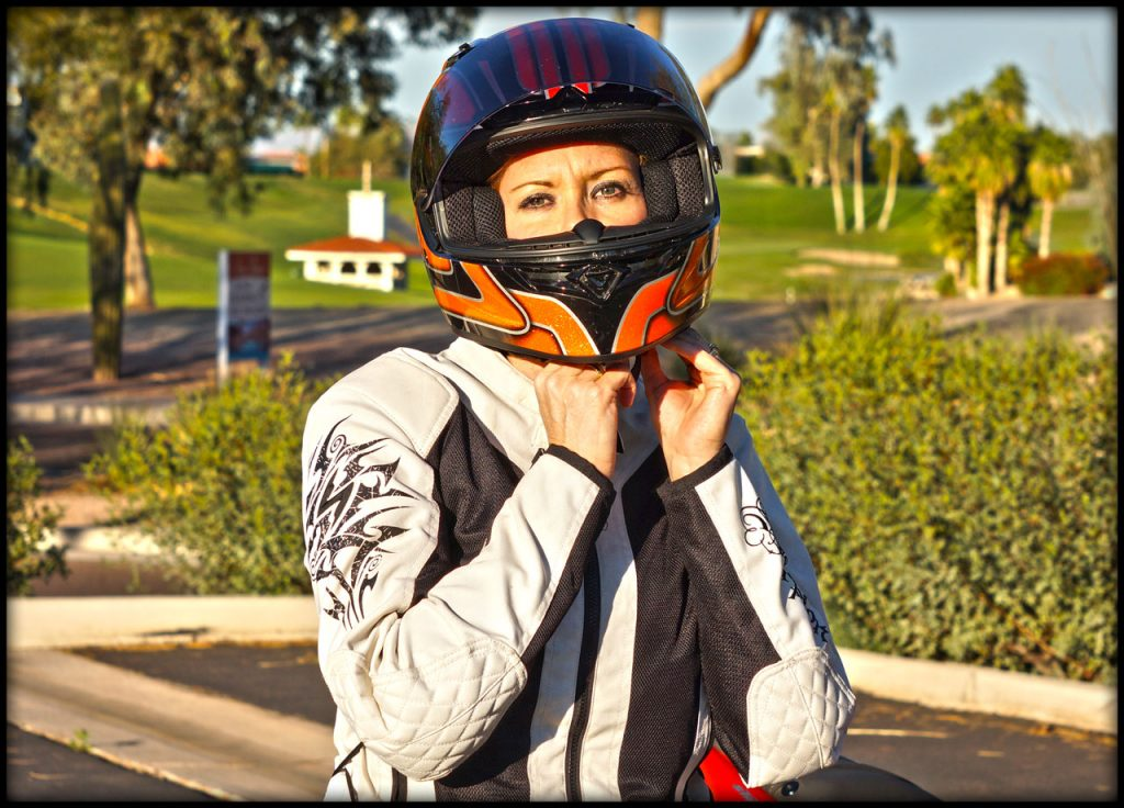 Kelly puts on her helmet before a ride